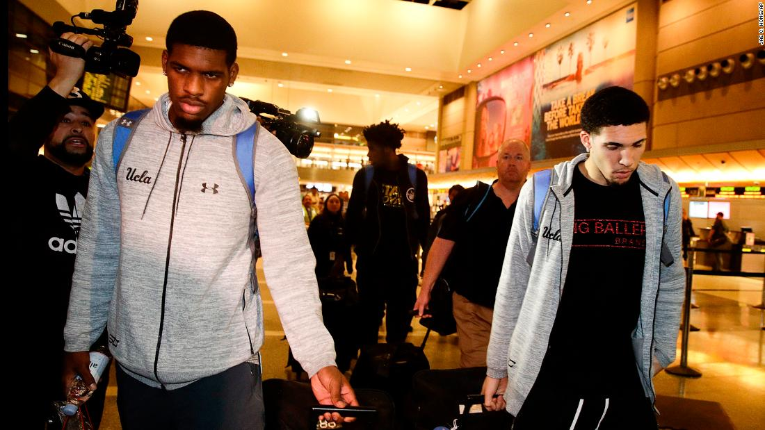 "UCLA basketball players Cody Riley, left, and LiAngelo Ball, right, leave Los Angeles International Airport after returning home from China on Tuesday, November 14. Riley, Ball and Jalen Hill -- seen at center in the background -- had been arrested ahead of the team's season opener in Shanghai. They were questioned on suspicion of stealing sunglasses from a Louis Vuitton store near their hotel. School officials said the charges were withdrawn by Chinese authorities after the players admitted guilt, and the players <a href=""http://www.cnn.com/2017/11/15/sport/ucla-basketball-players-statements/index.html"" target=""_blank"">publicly apologized</a> during a news conference back home."