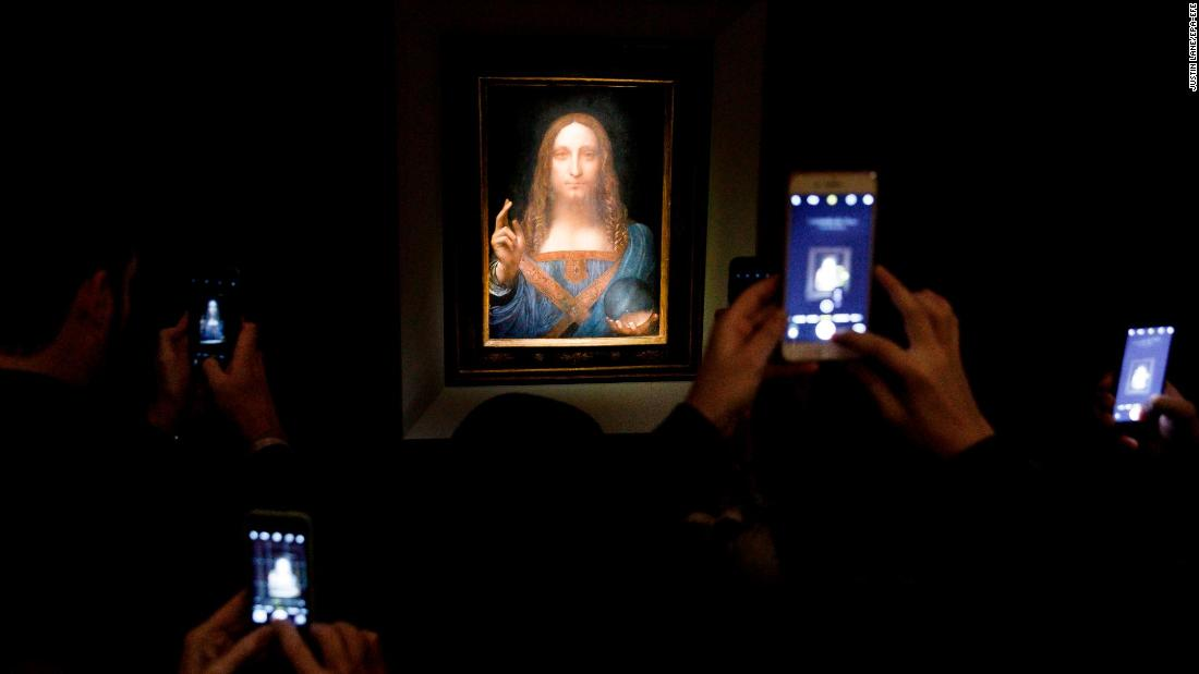 "People use their phones to take pictures of the Leonardo da Vinci painting ""Salvator Mundi"" before it was auctioned in New York on Wednesday, November 15. The rare painting has become <a href=""http://www.cnn.com/style/article/da-vinci-salvator-mundi-sale-christies/index.html"" target=""_blank"">the most expensive artwork to ever sell at auction,</a> going for $450.3 million."