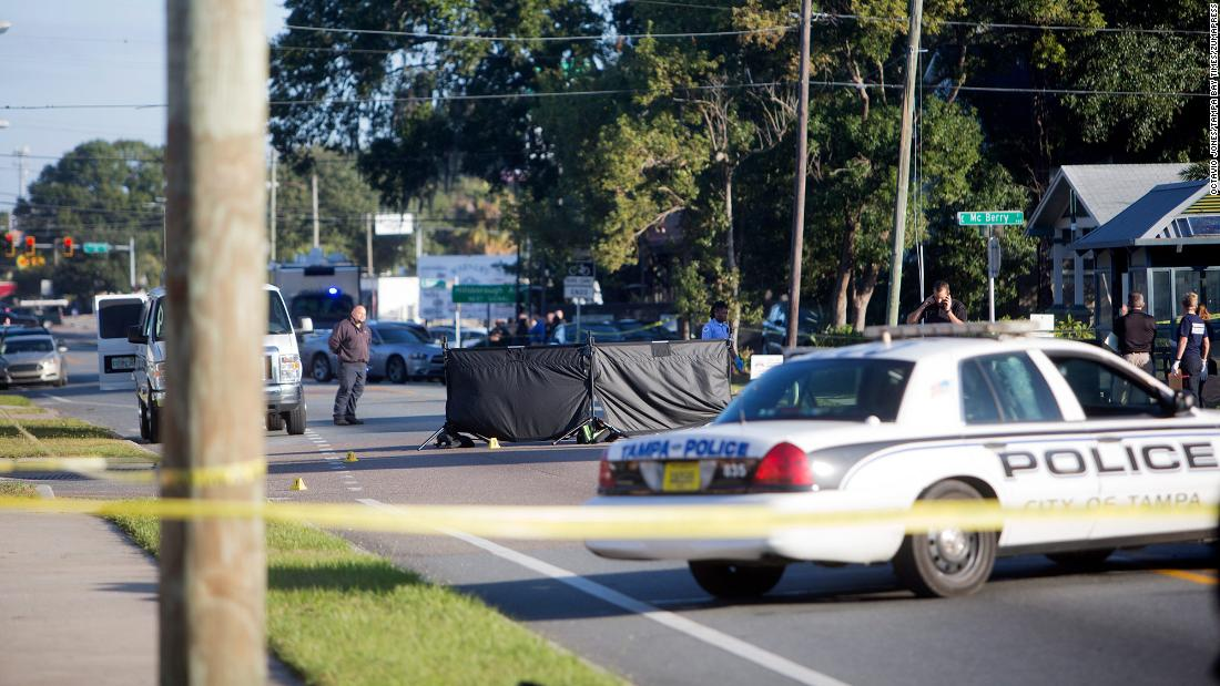 "Law enforcement officials investigate a fatal shooting in Tampa, Florida, on Tuesday, November 14. A 60-year-old man was shot and killed in the Seminole Heights area, the fourth such death in <a href=""http://www.cnn.com/2017/11/14/us/tampa-seminole-heights-unsolved-killings/index.html"" target=""_blank"">what police say is a string of unsolved killings in that neighborhood</a> within the past month."
