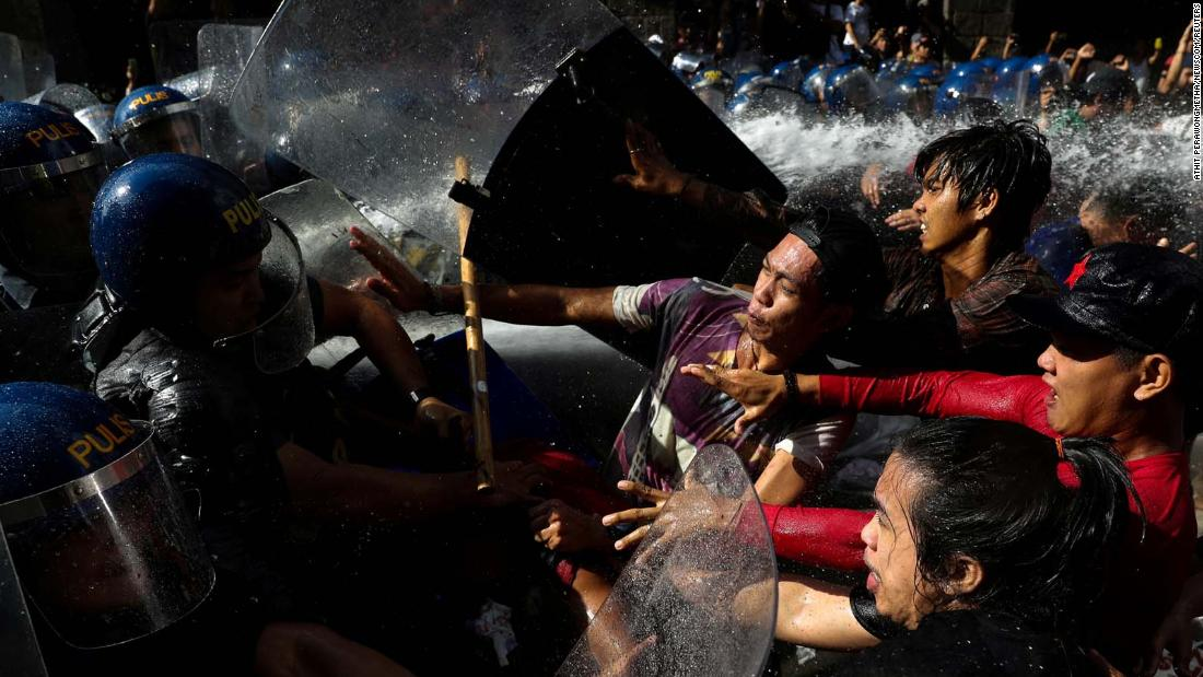 Protesters clash with police as they try to march toward the US Embassy in Manila, Philippines, on Sunday, November 12. The protesters were rallying against the visit of US President Donald Trump.