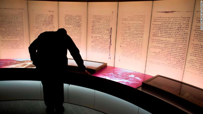Visitors look at an exhibit about the Dead Sea scrolls during a media preview of the new Museum of the Bible, a museum dedicated to the history, narrative and impact of the Bible, in Washington, DC, November 14, 2017. / AFP PHOTO / SAUL LOEB        (Photo credit should read SAUL LOEB/AFP/Getty Images)