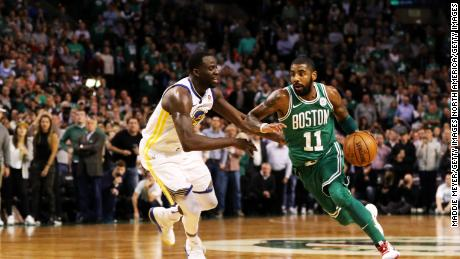 BOSTON, MA - NOVEMBER 16: Kyrie Irving #11 of the Boston Celtics drives against Draymond Green #23 of the Golden State Warriors during the fourth quarter at TD Garden on November 16, 2017 in Boston, Massachusetts. The Celtics defeat the Warriors 92-88. (Photo by Maddie Meyer/Getty Images)