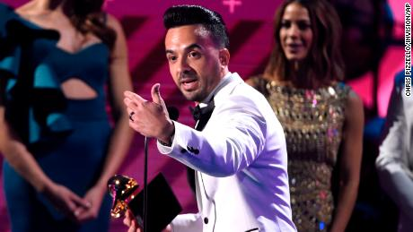 "Luis Fonsi accepts the award for record of the year for ""Despacito"" at the 18th annual Latin Grammy Awards at the MGM Grand Garden Arena on Thursday, Nov. 16, 2017, in Las Vegas. (Photo by Chris Pizzello/Invision/AP)"