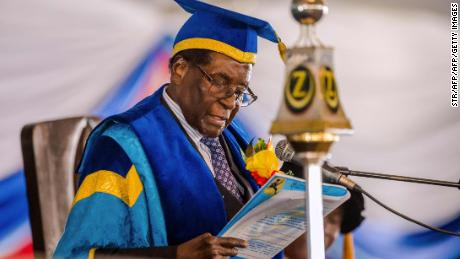 Zimbabwe's President Robert Mugabe delivers a speech during a graduation ceremony at the Zimbabwe Open University in Harare, where he presides as the Chancellor on November 17, 2017.  Zimbabwean President Robert Mugabe attended a university graduation ceremony today, making a defiant first public appearance since the military takeover that appeared to signal the end of his 37-year reign. / AFP PHOTO / STRSTR/AFP/Getty Images
