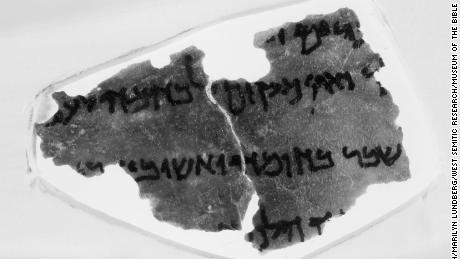 A fragment from the Museum of the Bible's collection of Dead Sea Scrolls. In this fragment, a snippet of text from the Book of Nehemiah, some scholars say they see an annotation from a 1937 edition of the Hebrew Bible, an obvious anachronism. The mark, which looks like a bitten apple, is on the far left of the third line of text.