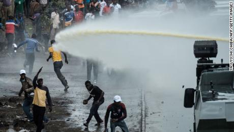 Kenyan police clash with supporters of  Raila Odinga upon his arrivalon Friday.