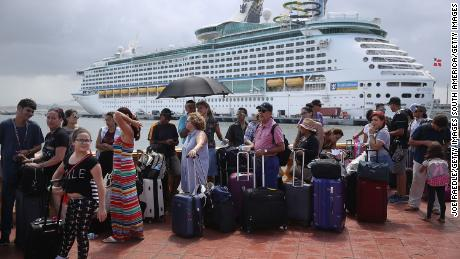 SAN JUAN, PUERTO RICO - SEPTEMBER 28:  People line up to get on a Royal Caribbean International, Adventure of the Seas, relief boat that is sailing to Ft. Lauderdale, Florida with evacuees that are fleeing after the island was hit by Hurricane Maria on September 28, 2017 in San Juan, Puerto Rico.  Puerto Rico experienced widespread damage including most of the electrical, gas and water grid as well as agriculture after Hurricane Maria, a category 4 hurricane, passed through.  (Photo by Joe Raedle/Getty Images)