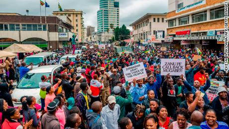 People march through a street in Harare on Saturday.