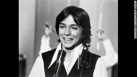 "(Original Caption) January, 1971-Actor David Cassidy, star of the hit television show, ""The Partridge Family,"" is seen in closeup, candidly smiling. UPI b/w photograph."