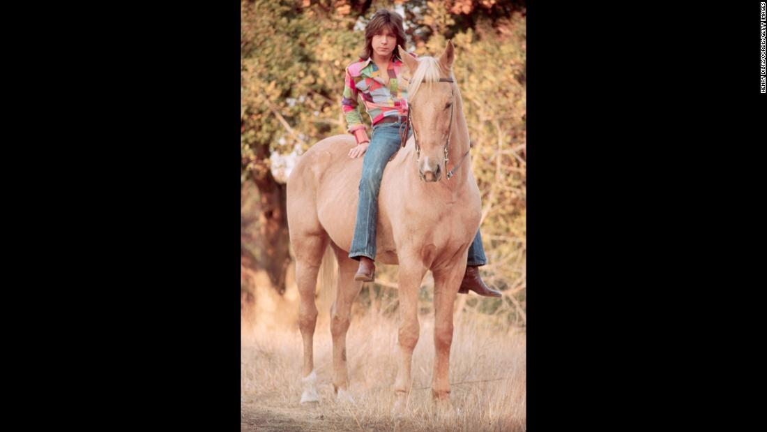 Posters of Cassidy graced the walls of young girls everywhere in the early '70s. Here he poses on a horse.