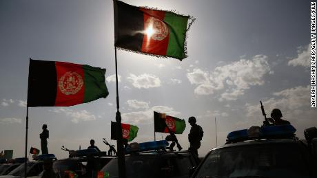 Afghan security forces wave their banner in August in honor of the Muslim holiday Eid.