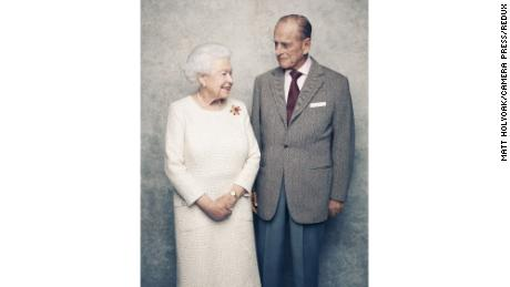 The portraits, by British photographer Matt Holyoak of Camera Press, were taken in the White Drawing Room at Windsor Castle in early November. Her Majesty wears a cream day dress by Angela Kelly, also worn at the Diamond Wedding Anniversary Service of Thanksgiving. The Queen is also wearing the 'Scarab' brooch in yellow gold, carved ruby and diamond, designed by Andrew Grima,  given as a personal gift from the Duke to The Queen in 1966. In the photo, the Queen and His Royal Highness are framed by Thomas Gainsborough's 1781 portraits of George III and Queen Charlotte, who were married for 57 years.  The marriage of the then Princess Elizabeth to Lieutenant Philip Mountbatten at Westminster Abbey on 20th November 1947 attracted worldwide attention. Distribution of the official wedding images, by the photographer Baron, were the first assignment of a new photo agency, Camera Press, which also celebrates its 70th year in 2017.
