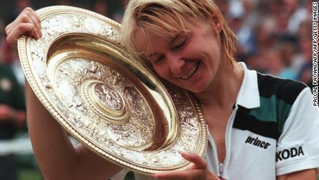 WIMBLEDON, UNITED KINGDOM:  Czech Republic's Jana Novotna enjoys her championship trophy after beating Nathalie Tauziat of France in the final of the women's singles at the Wimbledon Tennis Championships 04 July. Novotna won 6-4, 7-6. (Photo credit should read PASCAL PAVANI/AFP/Getty Images)