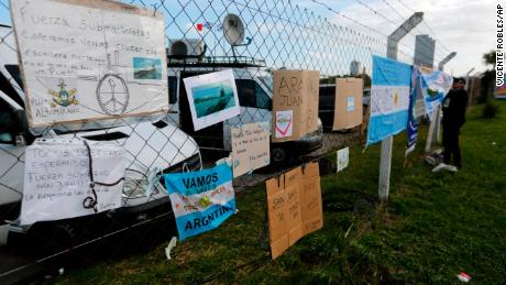 Messages of support for the crew of the San Juan hang from the fence at the naval base in Mar del Plata, Argentina.