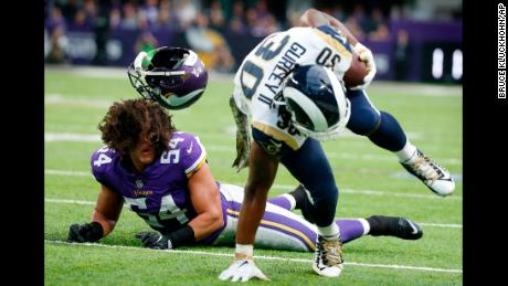 Minnesota Vikings middle linebacker Eric Kendricks, left, loses his helmet as he chases Los Angeles Rams running back Todd Gurley (30) during the first half of an NFL football game, Sunday, Nov. 19, 2017, in Minneapolis. (AP Photo/Bruce Kluckhohn)