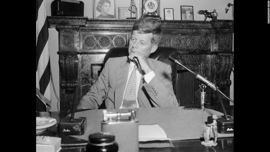 "In this image taken in his Senate office in January 1955, Kennedy is suffering from ramifications of his October 1954 spinal implant designed to fuse his spine and relieve his pain. An infection kept the incision from healing, creating an ""open, gaping ... hole,"" according to his speechwriter. The implant was removed in February."
