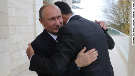 Russia President Vladimir Putin embraces his Syrian counterpart Bashar al-Assad during a meeting in Sochi, Russia, on Monday.