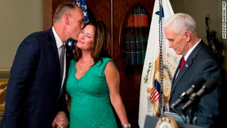 Interior Secretary Ryan Zinke, left, kisses his wife Lolita Hand after Vice President Mike Pence, right, administers the oath of office, Wednesday, March 1, 2017, in the Eisenhower Executive Office Building on the White House complex in Washington.