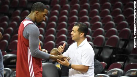 Cavaliers guard J.R. Smith (L) gets his hand checked by trainer Mike Mancias in practice during the 2016 NBA Finals.