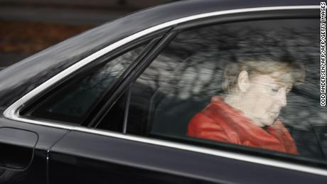 TOPSHOT - German Chancellor Angela Merkel leaves in her car the presidential residence Bellevue Castle in Berlin where she met the German President on November 20, 2017 after coalition talks failed overnight. Chancellor Angela Merkel was left battling for political survival on November 20 after high-stakes talks to form a new government collapsed, plunging Germany into a crisis that could trigger fresh elections. / AFP PHOTO / Odd ANDERSEN        (Photo credit should read ODD ANDERSEN/AFP/Getty Images)