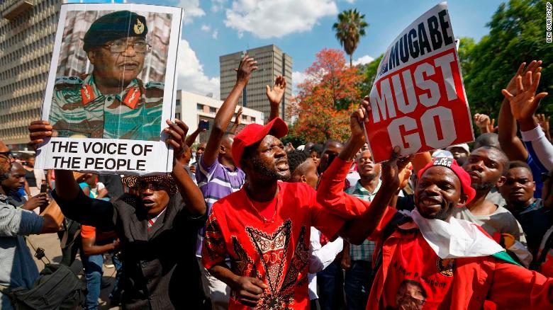 Protesters calling for the impeachment of President Robert Mugabe demonstrate in front of the parliament building in downtown Harare.