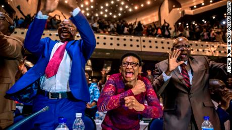 Parliamentarians celebrate Mugabe's resignation on Tuesday.