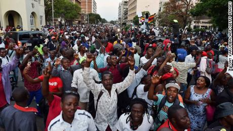 People celebrate in the streets of Harare, after the resignation of Zimbabwe's president Robert Mugabe on November 21, 2017.