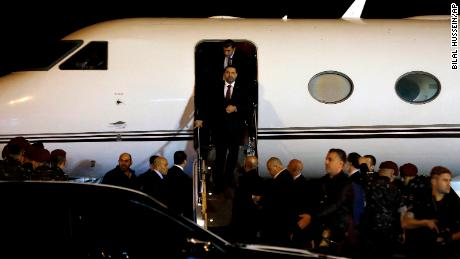 Hariri arrives at the airport in Beirut late Tuesday.