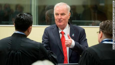 Former Bosnian military chief Ratko Mladic meets his lawyers at the tribunal.