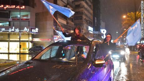 Hariri supporters wave Future Movement flags and celebrate his return on Tuesday.