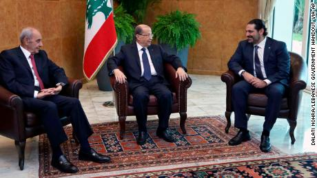 Lebanese President Michel Aoun (center) meets with Saad Hariri (right) on Wednesday.