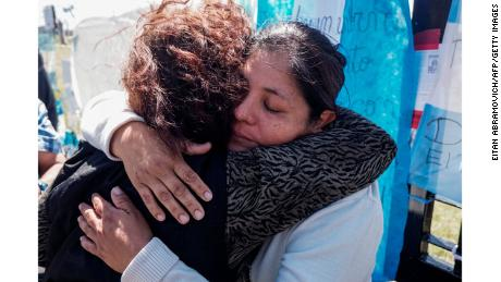 Elena Alfaro, right, sister of missing submariner Cristian Ibáñez, is comforted by a woman outside Argentina's navy base in Mar del Plata.