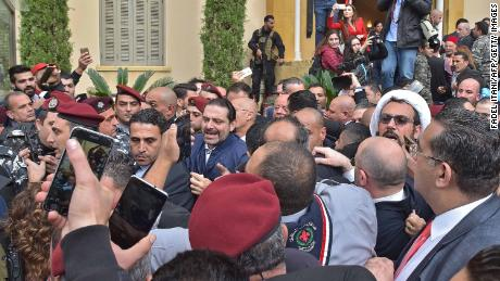 Saad Hariri (center) is welcomed by his cheering supporters in Beirut on Wednesday.