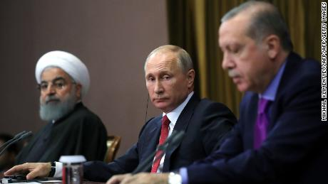 Russian President Vladimir Putin, center, addresses reporters with Iranian President Hassan Rouhani, left, and Turkish President Recep Tayyip Erdogan after a meeting on Syria in Sochi, Russia, on Wednesday.
