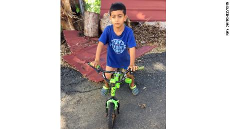 Elian Nieves, 6, gave his donated clothes to friends who were needier.
