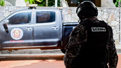 "Members of the Bolivarian National Intelligence Service (SEBIN) stand guard in front of the house of the mayor of Caracas, Antonio Ledezma -who had been arrested and jailed in February 2015 after being accused of plotting to overthrow the president- in Caracas on November 17, 2017. Ledezma, who was under house arrest following surgery, managed to escape and ""entered Colombian territory by land, over the Simon Bolivar international bridge"" Colombia's migration department said. / AFP PHOTO / FEDERICO PARRA        (Photo credit should read FEDERICO PARRA/AFP/Getty Images)"