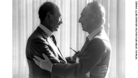 Egyptian President Anwar Sadat, left, greets then-Israeli opposition leader Shimon Peres in May 1979 in the southern Israeli city of Beersheva.