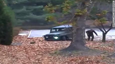 "TOPSHOT - This screengrab made from video footage released by the United Nations Command on November 22, 2017 shows a North Korea defector running out from a vehicle at the Joint Security Area of the Demilitarized Zone (DMZ). Dramatic footage of a North Korean soldier's defection released on November 22 showed him racing across the border under fire from former comrades, and then being hauled to safety by South Korean troops. The defector, who ran across the border at the Panmunjom truce village on November 13, was shot at least four times and has been recovering in a South Korean hospital. / AFP PHOTO / UNITED NATIONS COMMAND / Handout / RESTRICTED TO EDITORIAL USE - MANDATORY CREDIT ""AFP PHOTO / UNITED NATIONS COMMAND (UNC)"" - NO MARKETING NO ADVERTISING CAMPAIGNS - DISTRIBUTED AS A SERVICE TO CLIENTS  HANDOUT/AFP/Getty Images"