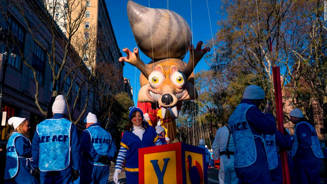 "A balloon of Scrat, the squirrel from the movie ""Ice Age,"" floats in the sky before the start of the Macy's Thanksgiving Day Parade in New York City."