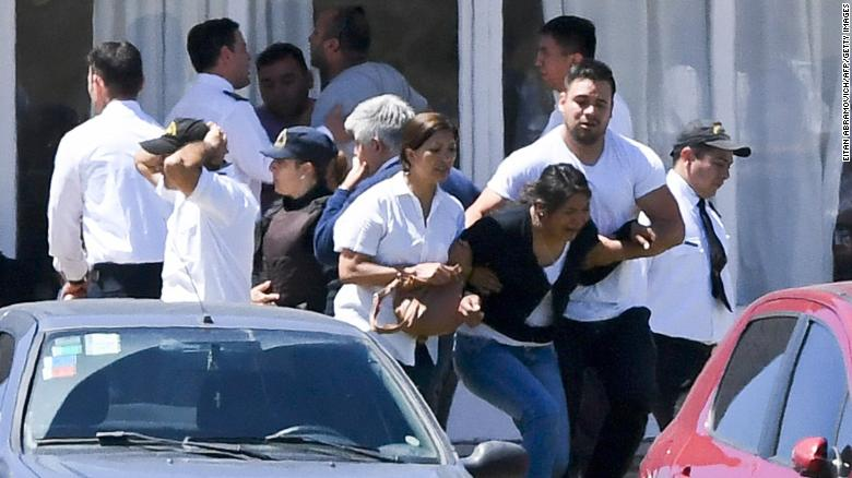 Relatives and friends of the missing submarine's crew members express their grief Thursday at Argentina's Navy base in Mar del Plata.