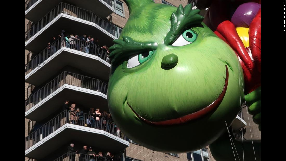 The Grinch balloon floats down Central Park West.