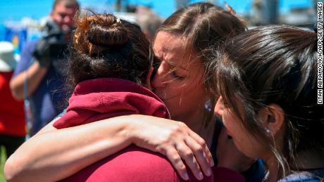 A relative of one of the 44 crew members in the missing submarine is  comforted outside Argentina's Navy base in Mar del Plata on November 23.