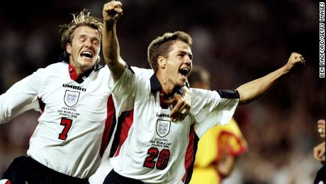 Michael Owen celebrates a goal with England teammate David Beckham at the 1998 World Cup.
