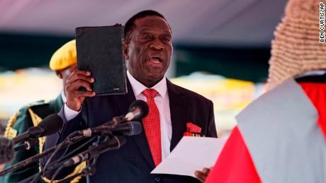 Emmerson Mnangagwa is sworn in as President at the presidential inauguration ceremony in the capital Harare, Zimbabwe Friday, Nov. 24, 2017. Mnangagwa is being sworn in as Zimbabwe's president after Robert Mugabe resigned on Tuesday, ending his 37-year rule. (AP Photo/Ben Curtis)