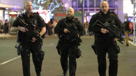 "Armed police patrol near Oxford street as they respond to an incident in central London on November 24, 2017. British police said they were responding to an ""incident"" at Oxford Circus in central London on Friday and have evacuated the Underground station, in an area thronged with people on a busy shopping day. / AFP PHOTO / Daniel LEAL-OLIVAS        (Photo credit should read DANIEL LEAL-OLIVAS/AFP/Getty Images)"