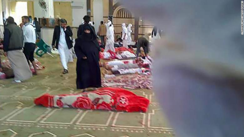 Bodies lie on the floor of Bir Al-Abed's Al Rawdah mosque following a gun and bomb attack Friday.