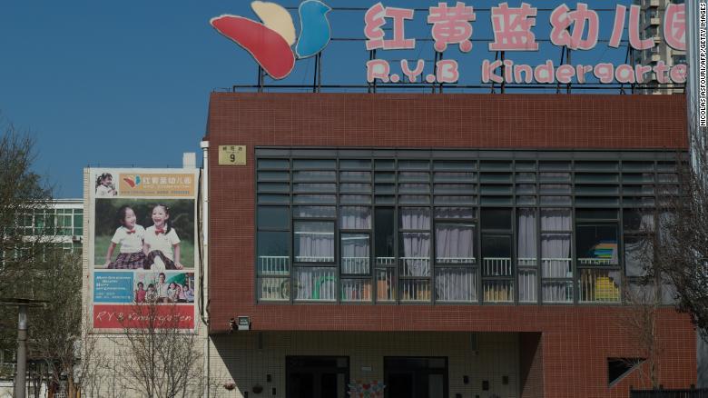 People leave the RYB Education New World kindergarten in Beijing on November 24, 2017.