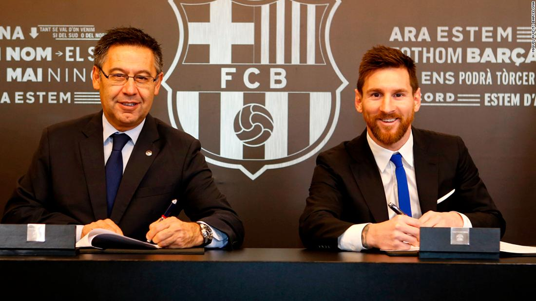 Lionel Messi re-signs with FC Barcelona through 2021