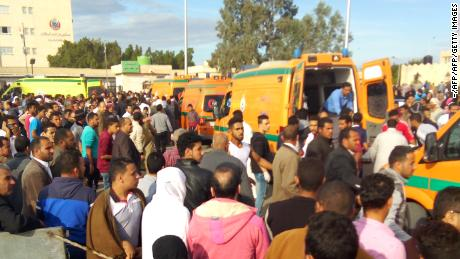 Egyptians gather around ambulances following a gun and bombing attack on the Rawda mosque near the North Sinai provincial capital of El-Arish on November 24, 2017. Armed attackers killed at least 235 worshippers in a bomb and gun assault on the packed mosque in Egypt's restive North Sinai province, in the country's deadliest attack in recent memory.   / AFP PHOTO / -        (Photo credit should read -/AFP/Getty Images)