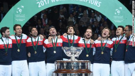 An ecstatic French team pose with the trophy after winning the Davis Cup final against France in Lille.